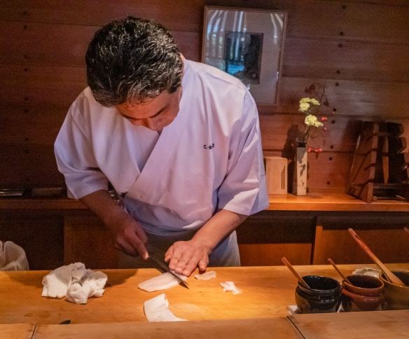 The master sushi chef preparing calamari by scoring the surface in several directions – it was amazingly tender; Otomezushi, Kanazawa, Honshu Island, Japan
