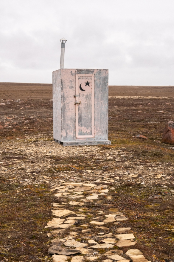 The signage is universal – a beach outhouse shack, Cambridge Bay, Victoria Island, Nunavut, Canada