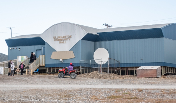 The Ulukhaktok Community Hall – note that the sign is an enlarged ulu; Victoria Island, Northwest Territories, Canada
