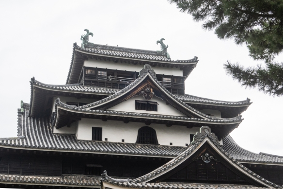 The watchtower and shachihoko (ornaments made of wood and plated with copper – here, two fish) at the top of the castle, Matsue Castle, Matsue City, Shimane Prefecture on Honshu Island, Japan