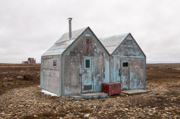 Vacation fishing shacks on the beach at Cambridge Bay, Victoria Island, Nunavut, Canada, built from plywood shipped in from southern Canada, as there are no trees in the tundra regions of the northern central Arctic region of Canada