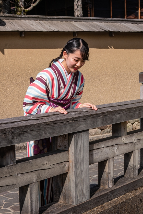 We came across three young women in traditional kimonos that were taking turns photographing each other on a bridge over a canal in the the Naga-michi neighborhood with samurai residences; Kanazawa, Honshu Island, Japan