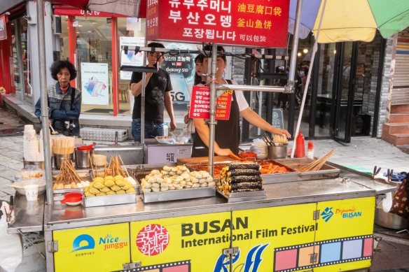 A downtown street food vendor with typical South Korean snacks , Busan, South Korea