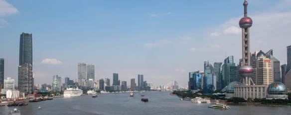 A panorama of the Huangpu River with our ship docked at the Shanghai Port International Cruise Terminal (on the left) and the Oriental Pearl TV Tower in Pudong, Shanghai, China