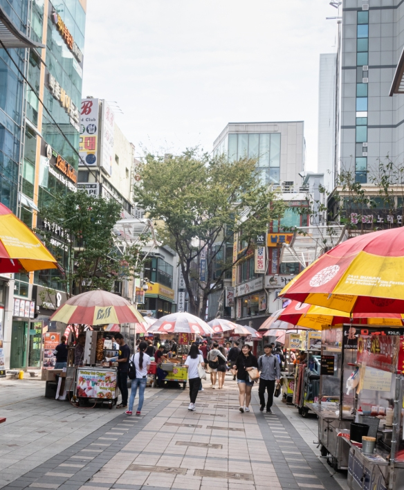 A pedestrian shopping street near BIFF Square lined with food carts in advance of the opening of the 2019 Busan International Film Festival, Busan, South Korea