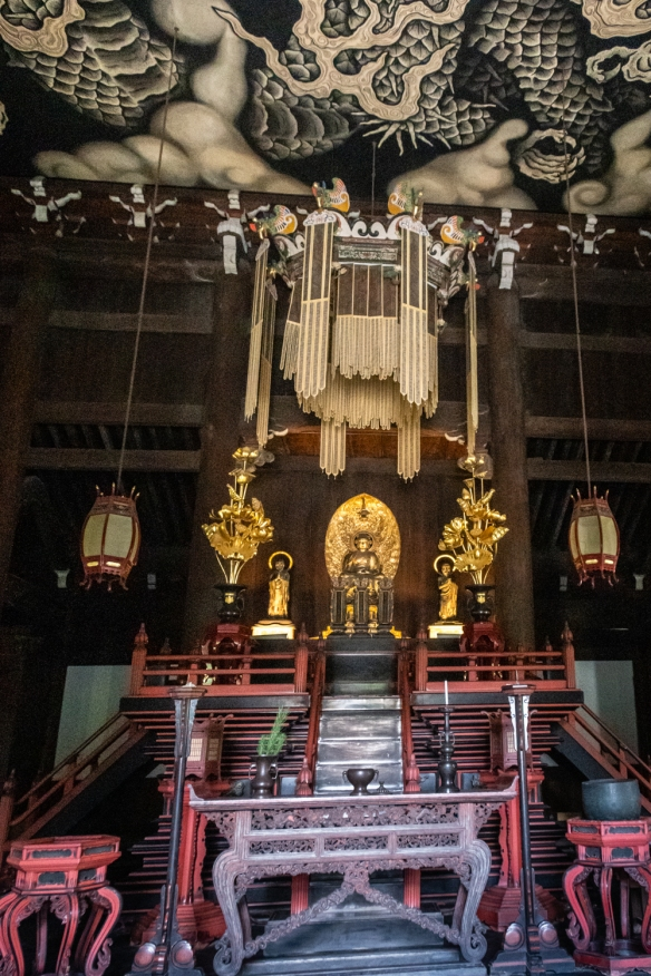 Buddha and sacred objects, under the ceiling mural of twin dragons, at the Main Hall, Kenninji Temple, Kyoto, Honshu Island, Japan