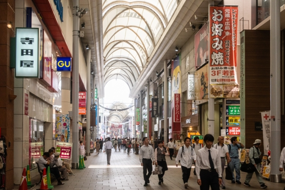From the Hiroshima Peace Memorial Park, we walked through the covered Hondori shopping arcade to Okonomimura where we had okonomiyaki (a savory pancake) for lunch, Hiroshima, Honshu Island, Japan