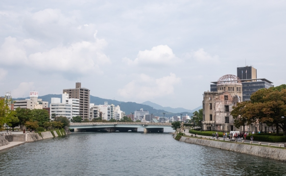 Reconstructed, modern downtown Hiroshima, Honshu Island, Japan, viewed from the bridge on the Motoyasu River leading from the ruins of Genbaku Dome (on the right) to Hiroshima Peace Memorial Park