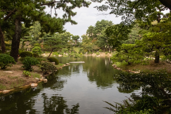 """Shukkeien Garden, literally meaning """"shrunken scenery garden"""", contains a central pond surrounded by mountains, valleys. Bridges, tea houses and arbors that are skillfully arranged; Hiroshima, Honshu Island, Japan"""