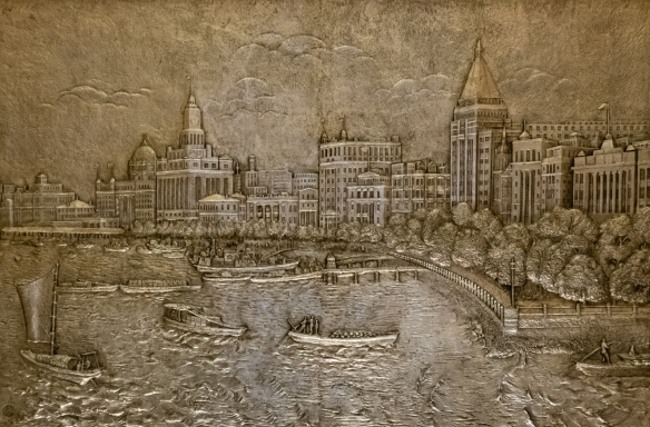 "The atrium of the Fairmont Peace Hotel contains several 1929 metal ""frescoes"" of scenes of Shanghai of the era; this one depicts buildings along the Bund (looking south) with boats approaching the quay"