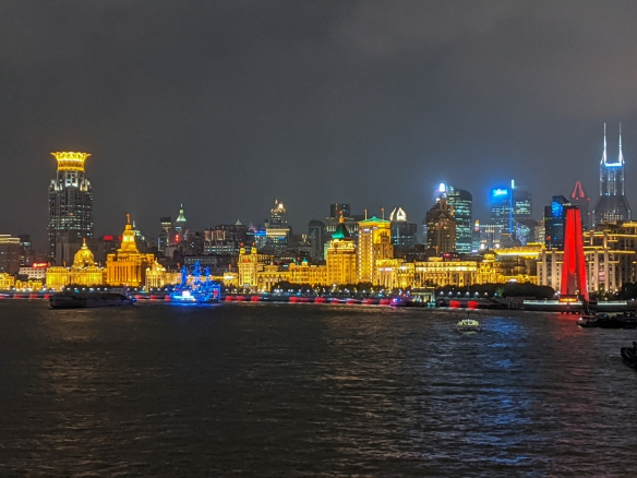 The brightly lighted buildings along the colonial-era Bund, the most famous street in Shanghai, made popular in the early 20th century when Shanghai was the Paris of the Orient, Shanghai, China