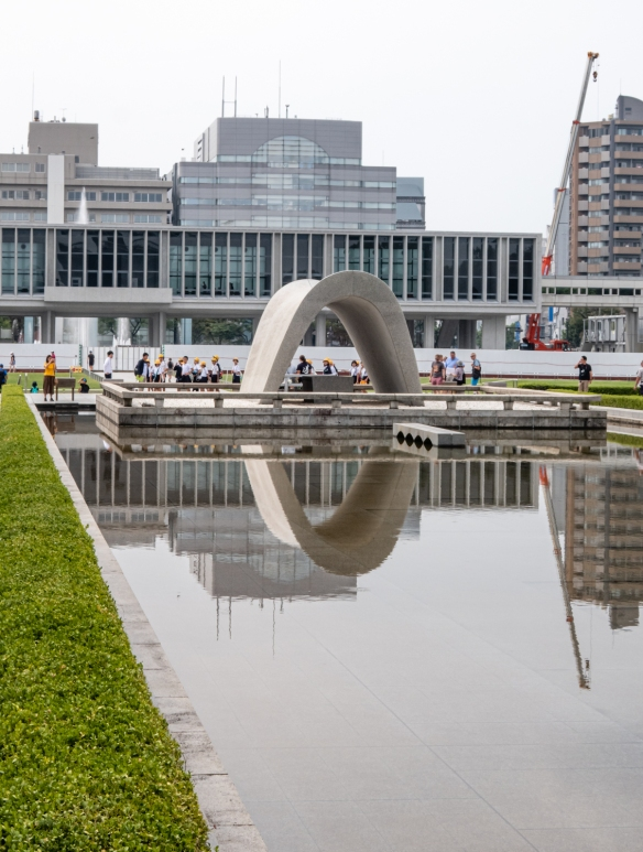 The Cenotaph and reflecting pool in the Hiroshima Peace Memorial Park; Honshu Island, Japan