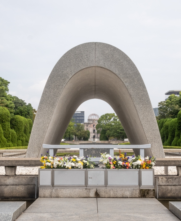 The Cenotaph with the ruins of Genbaku Dome in the distance, Hiroshima Peace Memorial Park; Honshu Island, Japan