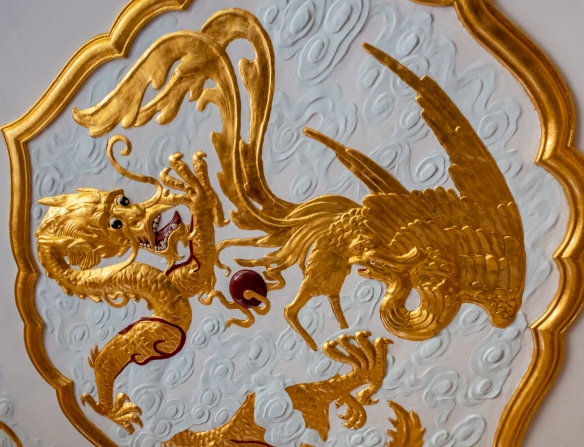 The eponymous Dragon and Phoenix in the ceiling panels at the at the beautifully restored Dragon and Phoenix restaurant at the Fairmont Peace Hotel, Shanghai, China