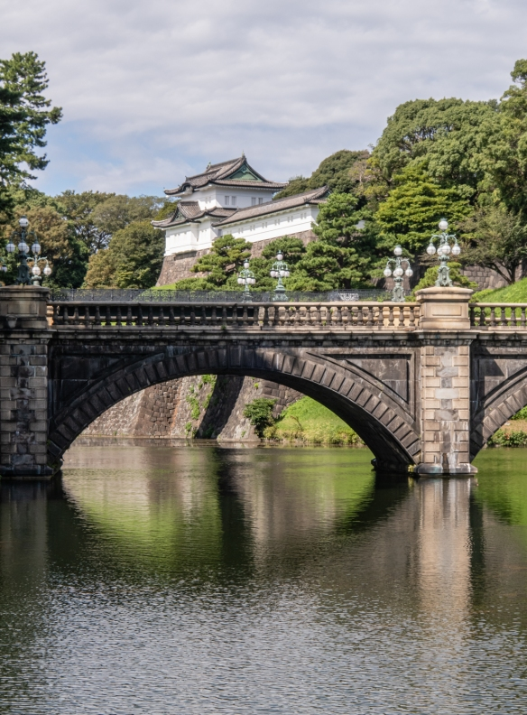 The Gardens of the Imperial Palace, Tokyo, Honshu Island, Japan #7 – the rebuilt (1968) Imperial Palace stands on a hill behind the Main Gate behind visible stone bridge and the (hidden) Nijubashi Bridge (a second, iron bridge)