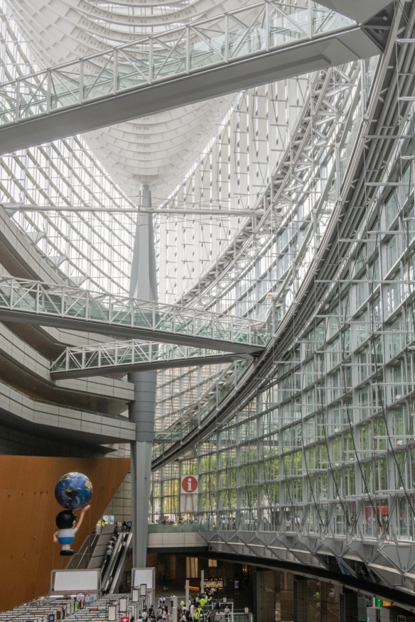 The lobby, inspired by the shape of a boat, is the height of an 11-story building, blending ample air and sunlight into its glass and steel framework and is linked by underground passageways to the huge auditorium wing across the courtyard, Tokyo