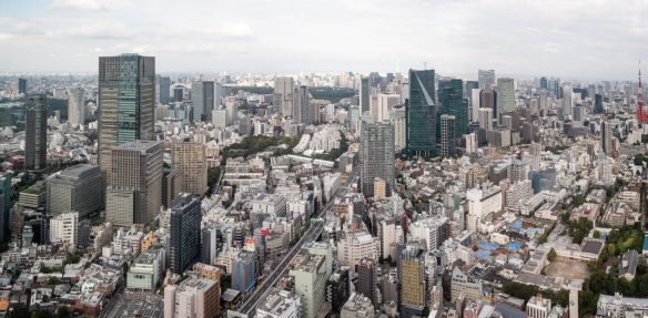 The view of the Shiodome, Odaiba, and Chiba districts of Tokyo, Japan, from the Observation Deck on the 52nd floor of the Mori Tower in the upscale Roppongi Hills development