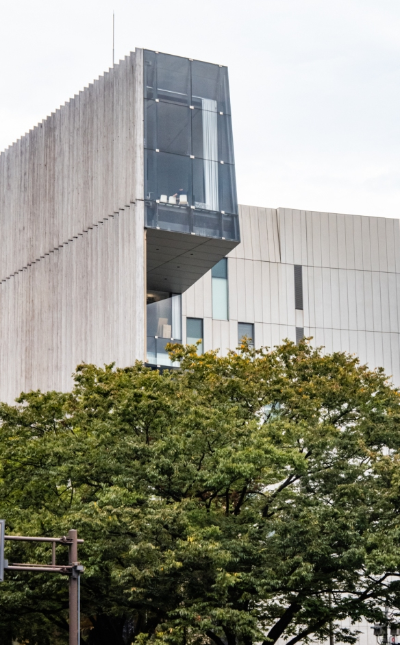 Tokyo architecture walk, Honshu Island, Japan #14 – a uniquely cantilevered section of an office building on Omotesando Avenue, a sloping tree-lined boulevard in Tokyo's fashionable Aoyama district