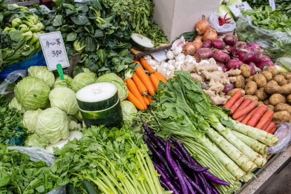 Fresh vegetables and greens for sale at a vendor's stall, Guangyuan Lu Market, Shanghai, China