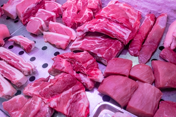 Pork is a mainstay protein in Chinese cuisine – it's so important that China has a strategic pork reserve, comparable to the United States' strategic petroleum reserve; Guangyuan Lu Market, Shanghai, China