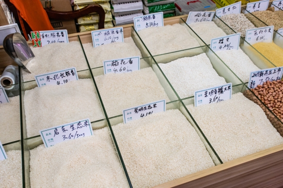 Rice comes in many varieties and quality levels (with a range of prices, as noted in the labels), Guangyuan Lu Market, Shanghai, China