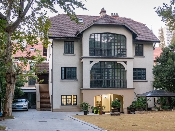 This company-owned private home (with a Bentley in the driveway) cost around US$25 million to purchase (before renovations), along with a commitment by the new owner of the house to provide lifetime free rentals elsewhere in Shanghai