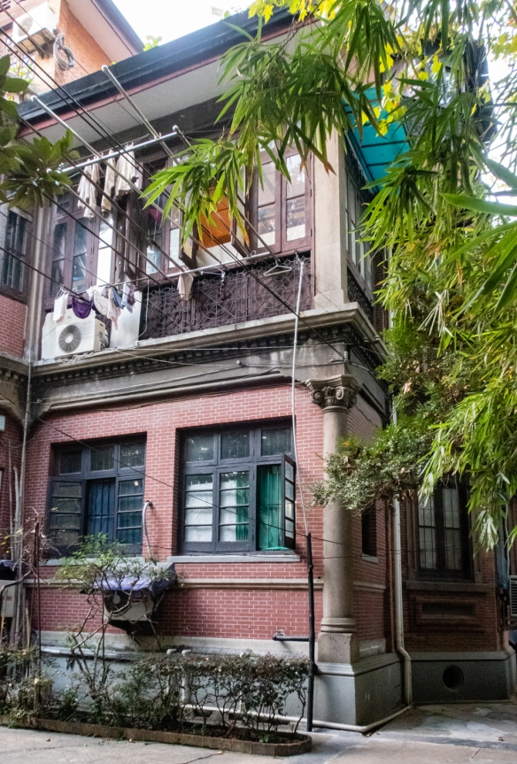 "This former private ""mansion"" home was seized, along with virtually all private property in Shanghai, by the Communist government in 1951 and carved up – each room was assigned to a family, French Concession, Shanghai, China"