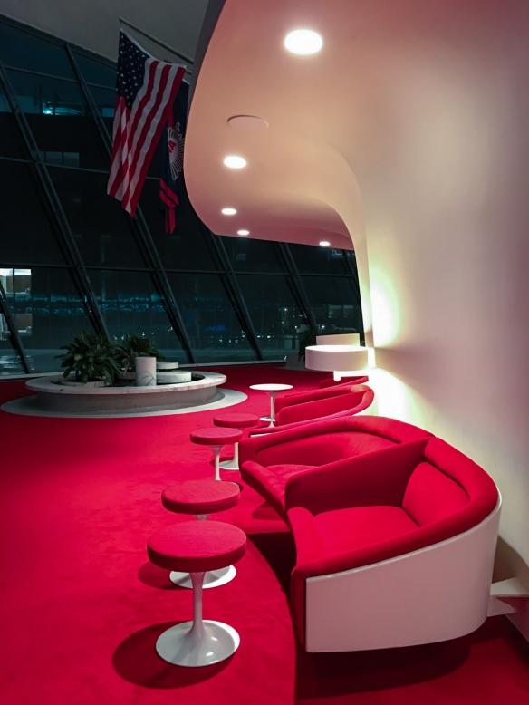 A lounge for hotel guests at the TWA Hotel, near the flight attendant uniforms exhibition, JFK International Airport, New York, NY, USA