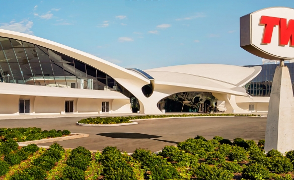"""The TWA Hotel now occupies Eero Saarinen's stupendously restored 1962 TWA Flight Center at John F. Kennedy International Airport, midcentury modernism's great tribute to sex, adventure and the golden age of air travel"""