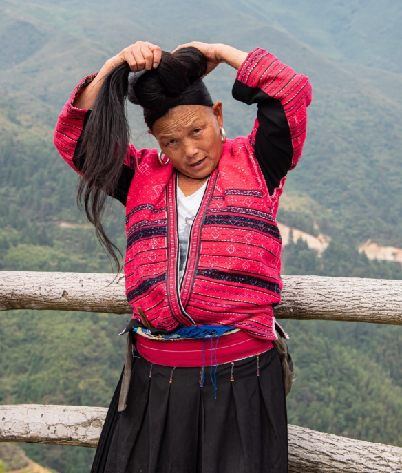 One of the two Yao women photographed with their long hair at the Jinkeng Red Yao Terraced Rice Fields, Dazhai Village, near Guilin, Guangxi, China #5