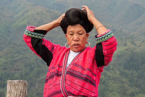 One of the two Yao women photographed with their long hair at the Jinkeng Red Yao Terraced Rice Fields, Dazhai Village, near Guilin, Guangxi, China #8