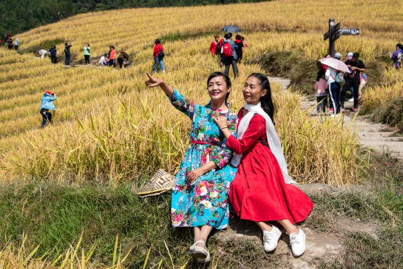 Ping'an Zhuang Village Terraced Fields, or Dragon's Backbone Rice Terraces, near Guilin, Guangxi, China #8; your photographer couldn't resist making a portrait of these two Chinese tourists as they posed for a friend in the rice terraces