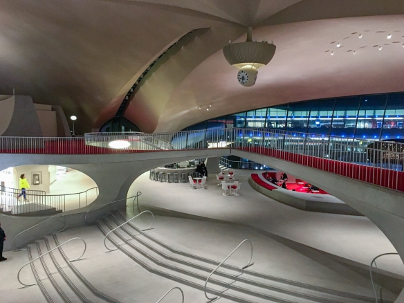 The central area of the former TWA terminal, now the TWA Hotel, opens up to the check-in area, the snack and coffee stand, the restaurant, lounge and special exhibits areas; JFK International Airport, New York, NY, USA