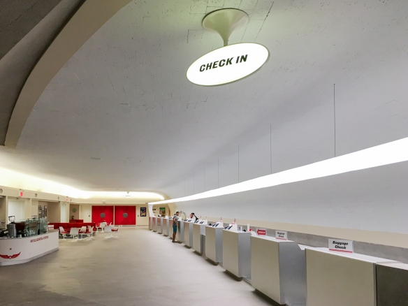 The former terminal check-in area is now the hotel check-in area – now heavily automated with guest self-check-in on computer screens; TWA Hotel, JFK International Airport, New York, NY, USA