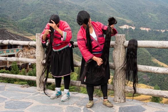 Two Yao women photographed with their long hair at the Jinkeng Red Yao Terraced Rice Fields, Dazhai Village, near Guilin, Guangxi, China #2