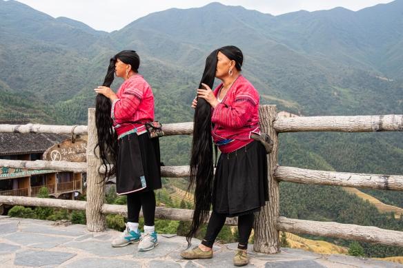 Two Yao women photographed with their long hair at the Jinkeng Red Yao Terraced Rice Fields, Dazhai Village, near Guilin, Guangxi, China #3