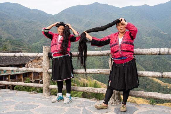 Two Yao women photographed with their long hair at the Jinkeng Red Yao Terraced Rice Fields, Dazhai Village, near Guilin, Guangxi, China #4