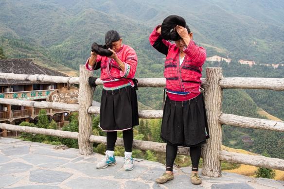 Two Yao women photographed with their long hair at the Jinkeng Red Yao Terraced Rice Fields, Dazhai Village, near Guilin, Guangxi, China
