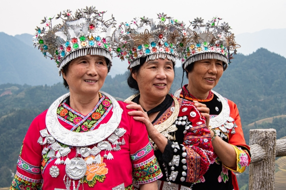 While visiting Jinkeng Red Yao Terraced Rice Fields inside the Dazhai Village, we saw many women of the Yao Ethnic Minority in their colorful native dress – they have their own unique and interesting customs in dinning, clothes, and living styles, etc