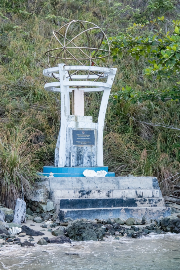 A close up of the equator monument, Kawe, Raja Ampat, Indonesia
