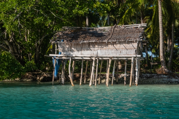 Cruising the lagoon of Boo Kecil Island, Boo Islands, Raja Ampat, Indonesia #2; a small fishing hut in the channel entrance to the lagoon