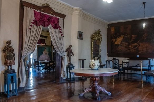 Drawing rooms in Syquia Mansion in Vigan, Philippines, with period furnishings, family portraits and memorabilia