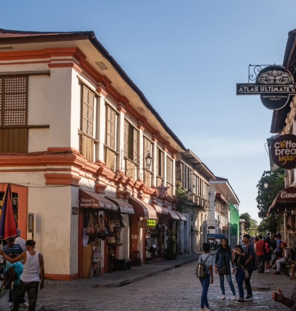 Historic buildings with shops, cafes and restaurants along Calle Cristologo, the main street in Vigan, Philippines