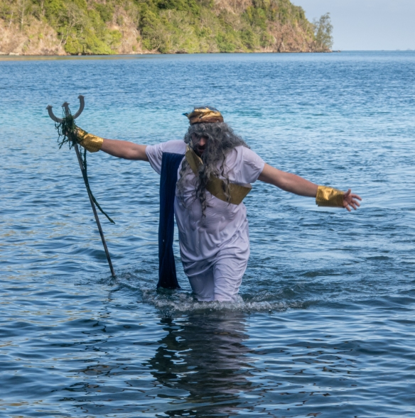 King Neptune emerges from the sea to lead the initiation of the Pollywogs, Kawe, Raja Ampat, Indonesia