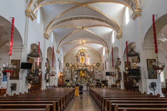 The interior of St. Paul's Cathedral with its silver-paneled main altar, Vigan, Philippines