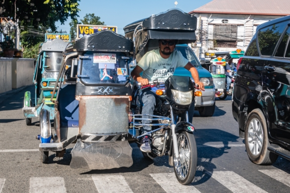 The main form of local transportation, especially for tourists, are these motorcycle side cars, Vigan, Philippines