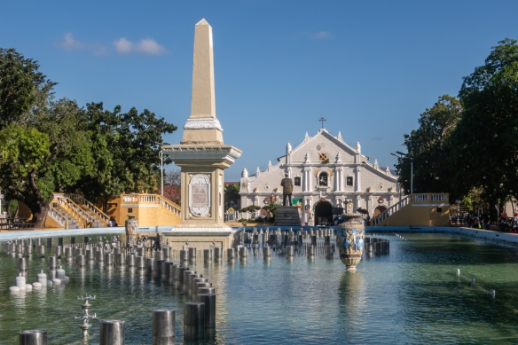 The Plaza Salcedo and fountains in the central park downtown, Vigan, Philippines, with Saint Paul's Cathedral in the background