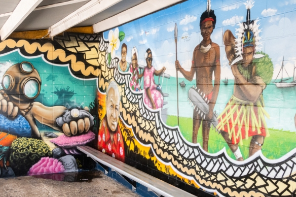 A mural at the local ferry pier showing indigenous peoples and local industry (pearl diving), Thursday Island, Torres Strait Islands, Queensland, Australia