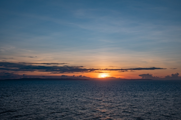 Sunset over the Australian mainland; Lizard Island, Queensland, Australia