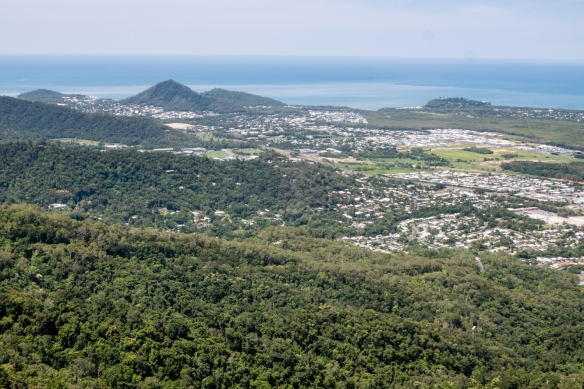 A bird's-eye view of the city of Cairns on the coast – the Great Barrier Reef, not visible at the top of the photograph, is in the Coral Sea, just off the east coast of Australia